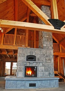 Masonry Heaters store heat in the structure built around the fireplace and chimney